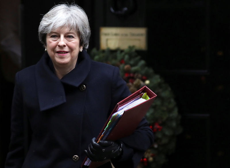 After defeat at home, Britain's May urges EU leaders to move on with Brexit