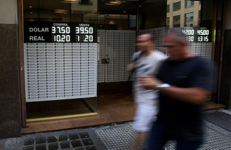 Argentina's billion-dollar buying spree reins in peso, rates