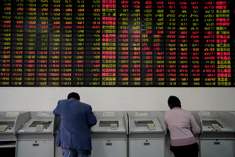 Asia stocks slightly up after Fed move; dollar, U.S. yields sag