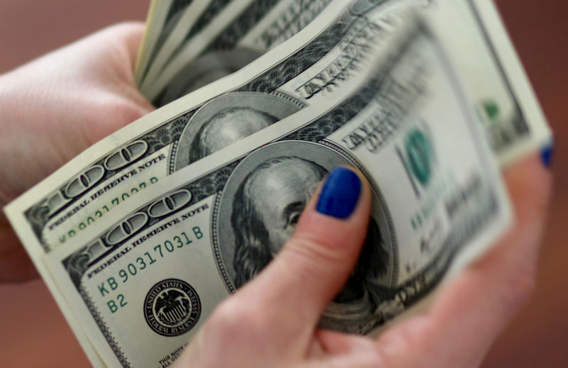 Dollar trades in narrow range as investors await Fed rate decision