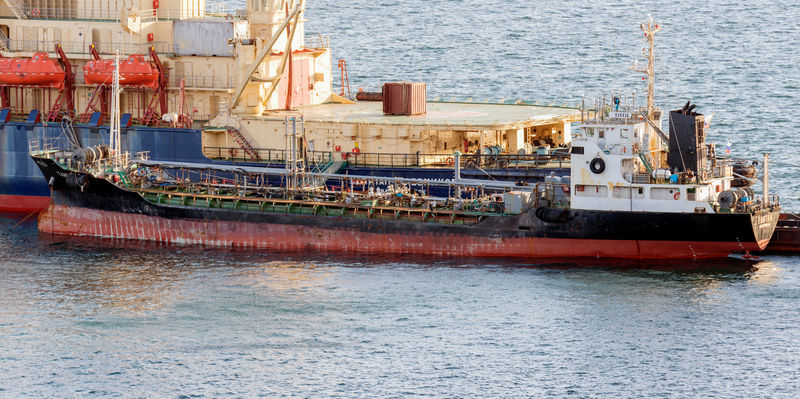 Exclusive: Despite sanctions, Russian tanker supplied fuel to North Korean ship-crew members