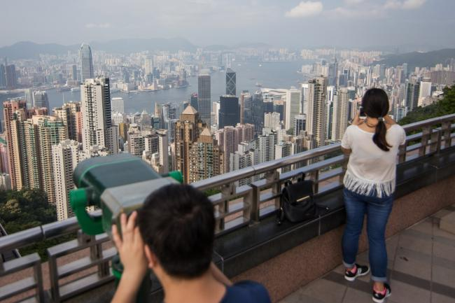Hong Kong Trims Budget Handouts With Slowing Economy in View