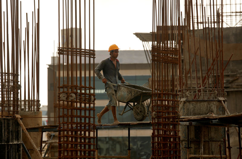 India lowers tax on new home sales ahead of general election