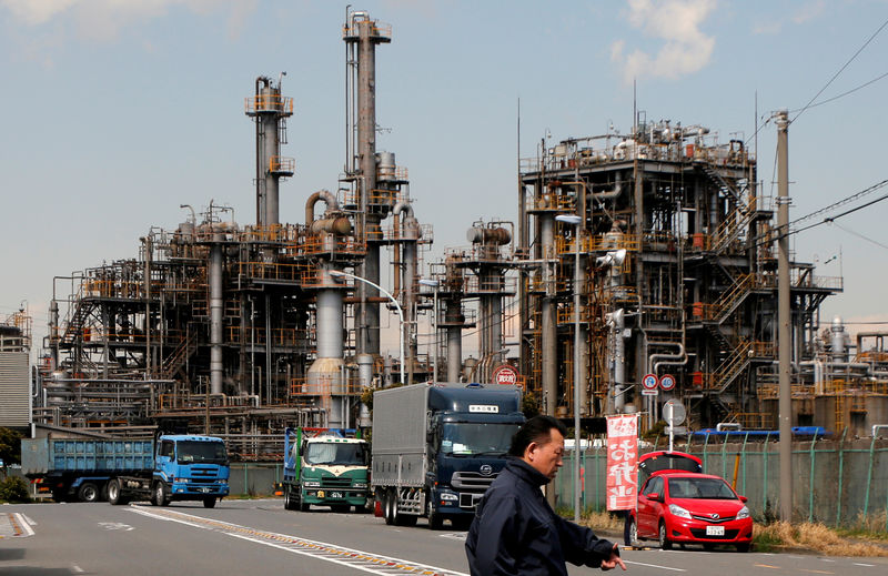 Japan's factory output posts biggest fall in a year, outlook sags