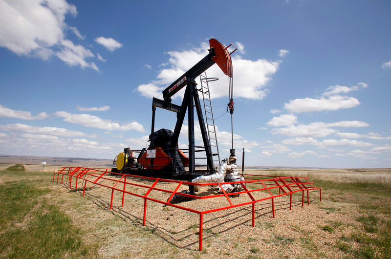 Oil prices dip as U.S. crude output hits record 12 million barrels per day