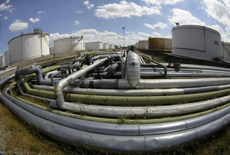 Oil Prices Turn Negative as U.S. Inventories, Production Jump