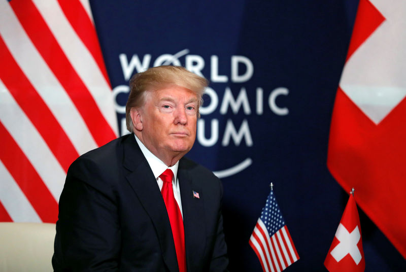 Trump confronts Davos on trade abuses, talks up dollar