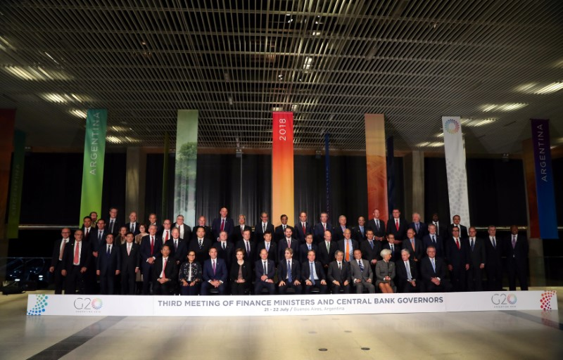 U.S. courts allies with free trade offers at G20, France resists
