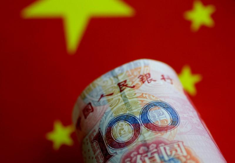 Yuan slumps, dollar on defensive after Trump comments