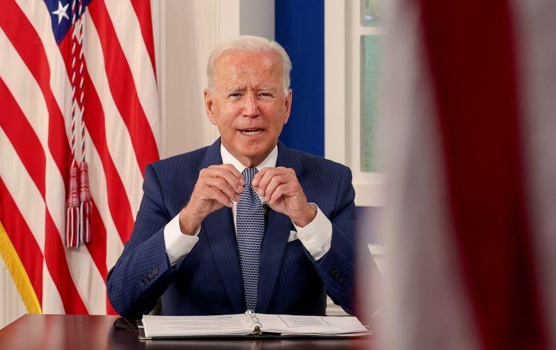 Biden signs bill raising U.S. debt limit, averting default