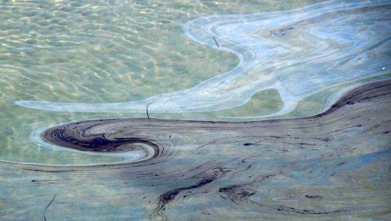 California oil spill cause probed; storm threatens cleanup