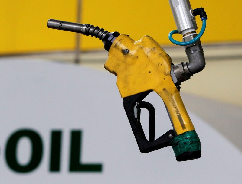Oil prices trim gains after big build in U.S. stocks