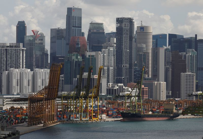 Singapore to forge on with economic recovery, central bank on hold